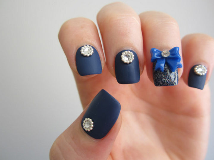 18 Perfectly Manicured Bow Nails - Navy blue nails with a big gorgeous bow and Swarovski crystal studs.