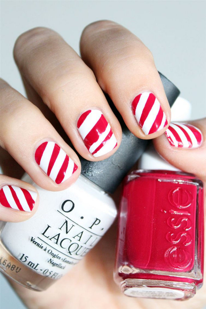 23 Christmas Nails - Get festive with sweet candy cane nails.