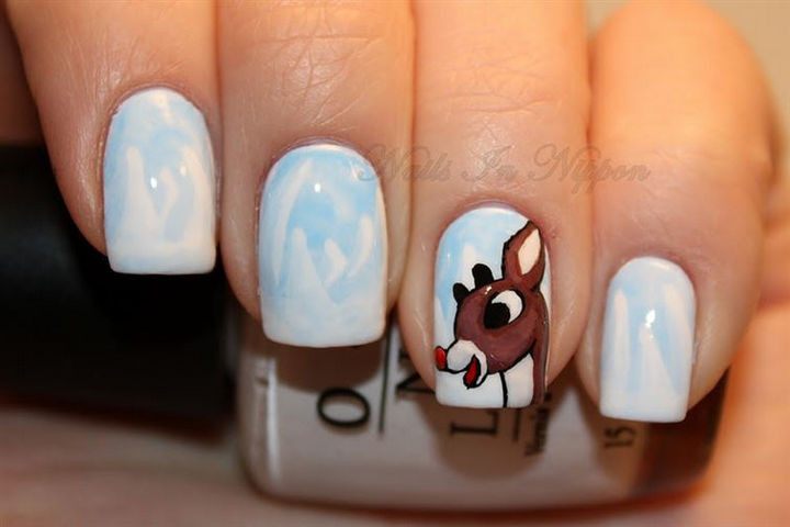 23 Christmas Nails - Celebrate your favorite Christmas special with Rudolph the Red-Nosed Reindeer nails.