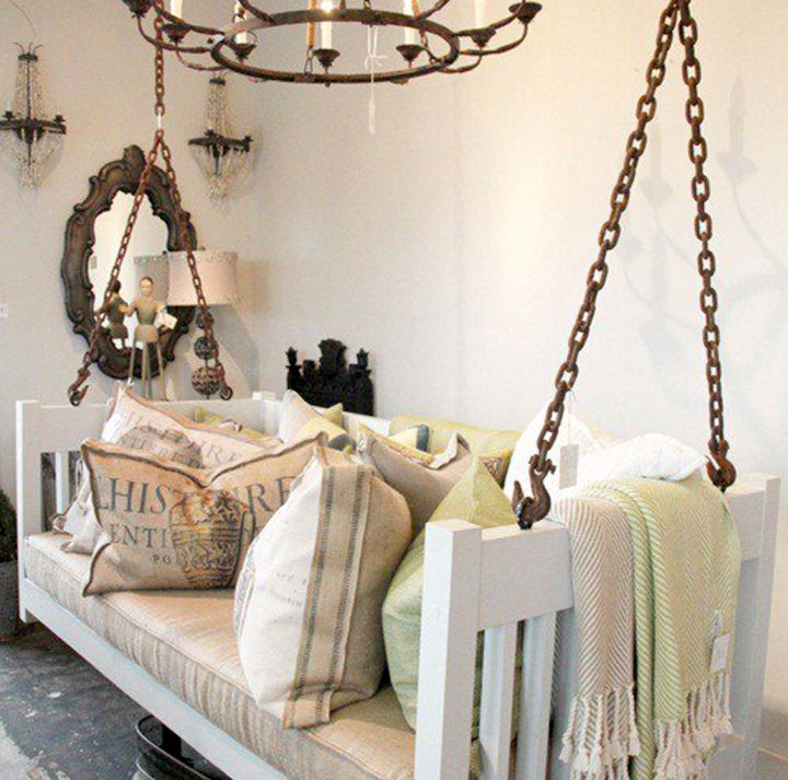 19 Ways to Repurpose Baby Cribs - Build a hanging bed swing.