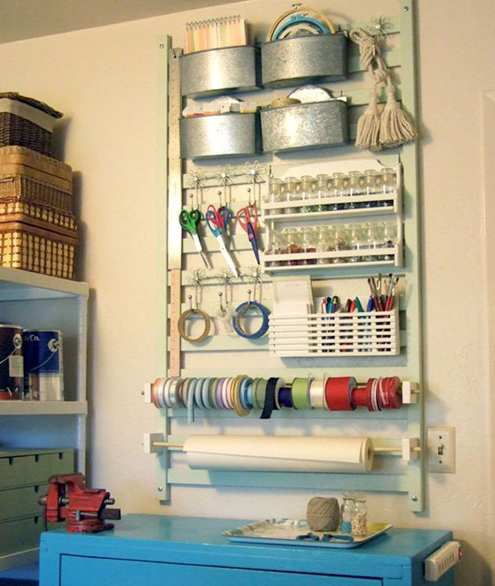 19 Ways to Repurpose Baby Cribs - Create a unique craft and tool station with organizer.