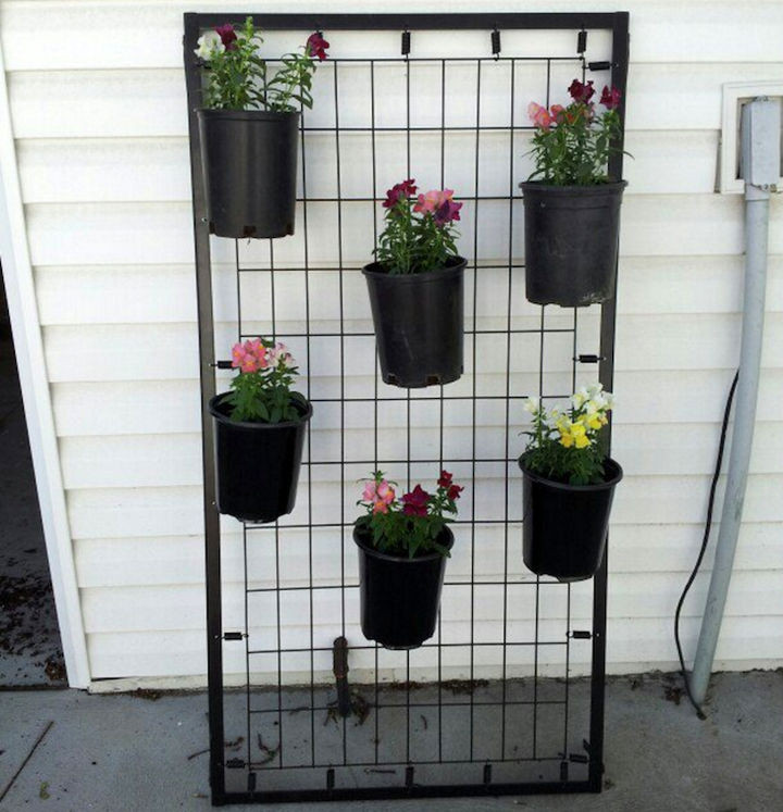 19 Ways to Repurpose Baby Cribs -Make a flower pot stand.