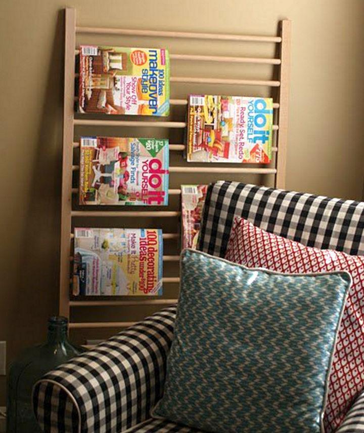 19 Ways to Repurpose Baby Cribs - Use a crib railing as a magazine rack.