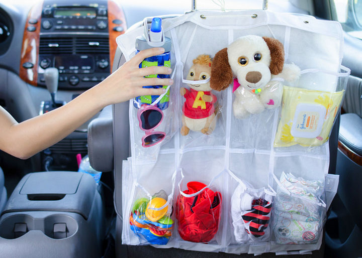 21 Clever Shoe Organizer Ideas - Keep children entertained on a road trip by creating backseat pockets.
