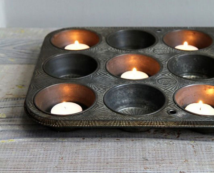 13+ Muffin Pan Hacks - Use a muffin tray as a votive candle holder.