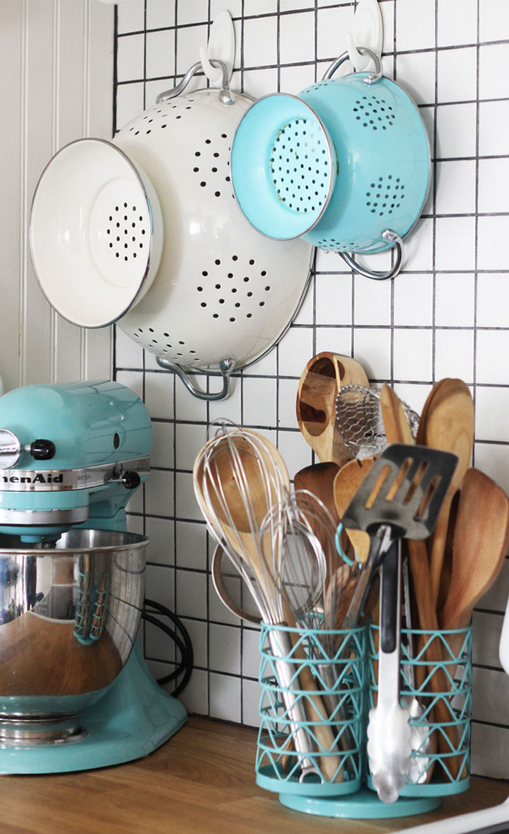 Make room in your cupboards by keeping colanders within easy reach.