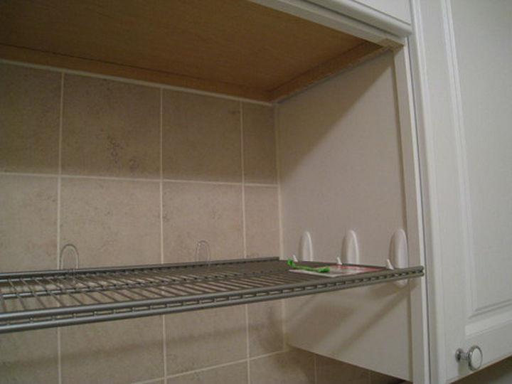Hang a shelf with command hooks.
