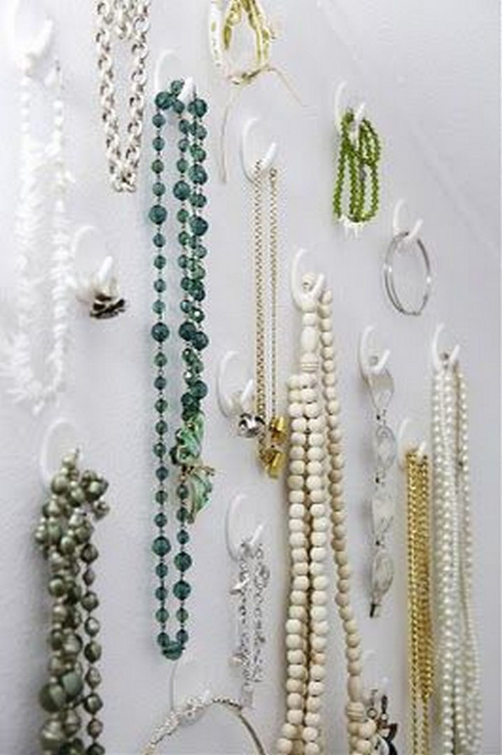 Prevent tangled jewelry by organizing them with command hooks.