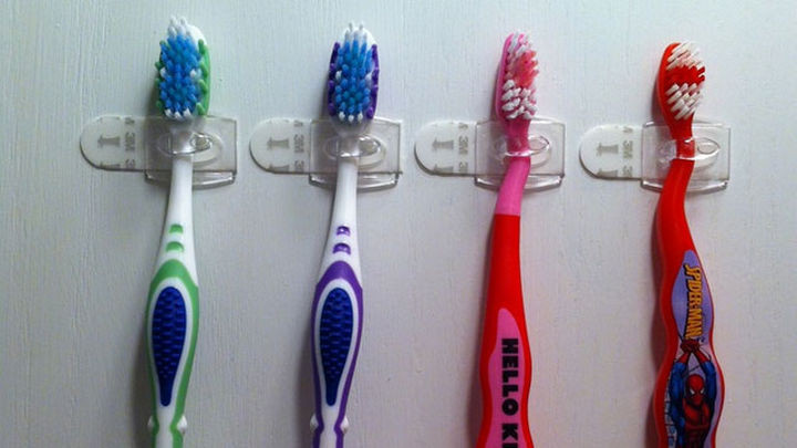 Neatly store toothbrushes in your medicine cabinet.