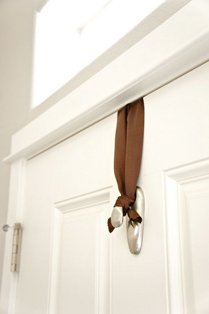Hang a door wreath without nails.