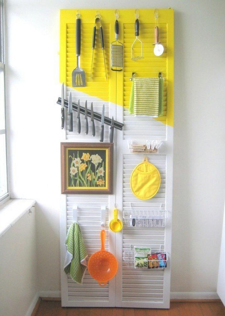 Transform an old door into a kitchen organizer.