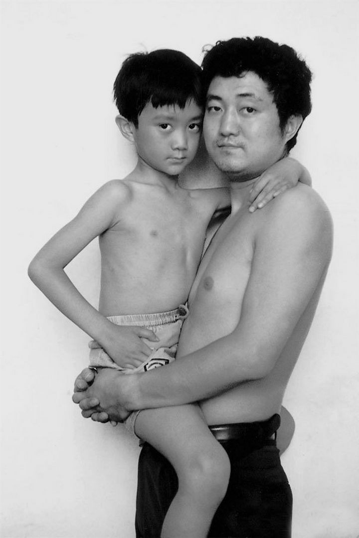Father takes photo with his son every year. This one was taken in 1995