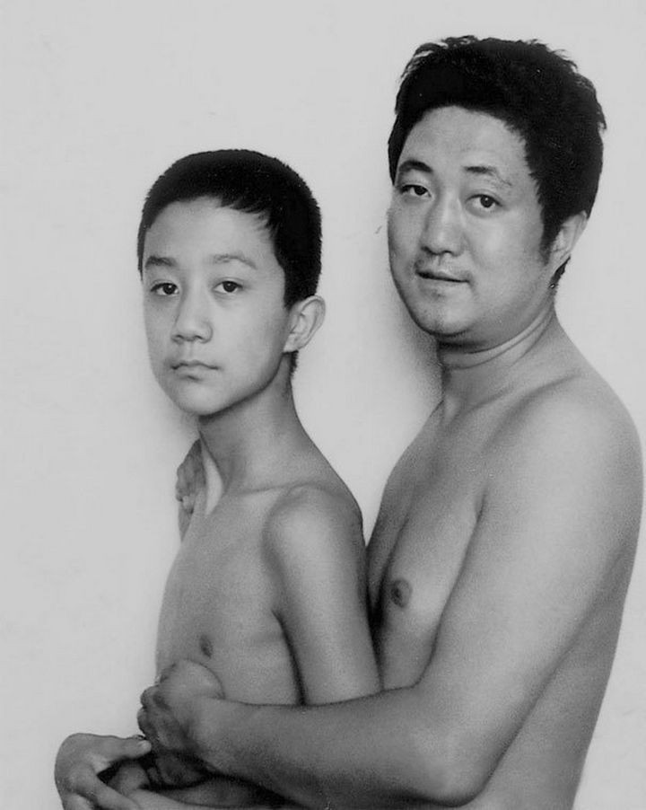 Father takes photo with his son every year. This one was taken in 1998