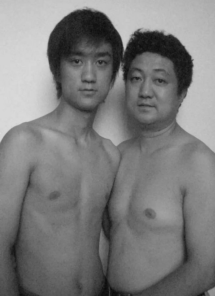 Father takes photo with his son every year. This one was taken in 2005.