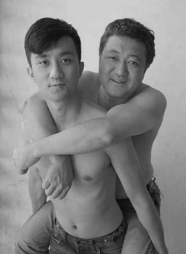 Father takes photo with his son every year. This one was taken in 2013.
