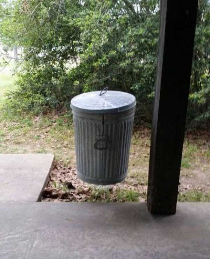 31 Hilariously Misleading Photos - That isn't a levitating trash can.