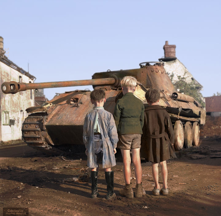 35 Rare Historical Photos - 1944: Three French boys looking at a German Panther tank which was destroyed in the Falaise pocket, Normandy