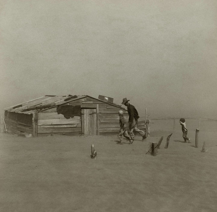 35 Rare Historical Photos - 1936: A farmer and his sons walking through a dust storm in Oklahoma.