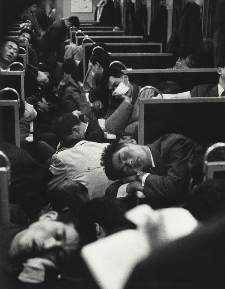 35 Rare Historical Photos - 1964: Early morning commuters resting on the way to work on a train in Japan.