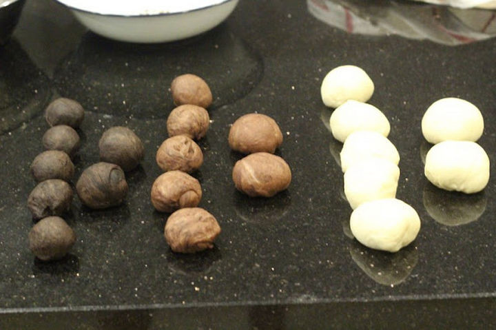 The dough is divided and rolled into smaller balls of dough.