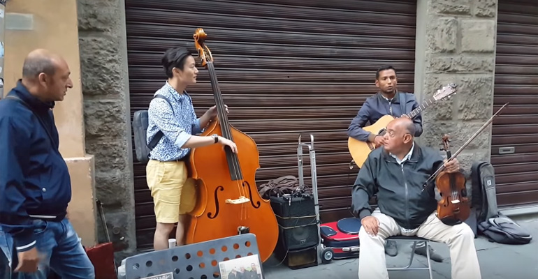 Tourist Jams with Street Musicians in Italy.