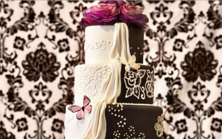 12 Him and Her Wedding Cake Ideas - Lovely butterflies add a whimsical touch to this wedding cake.