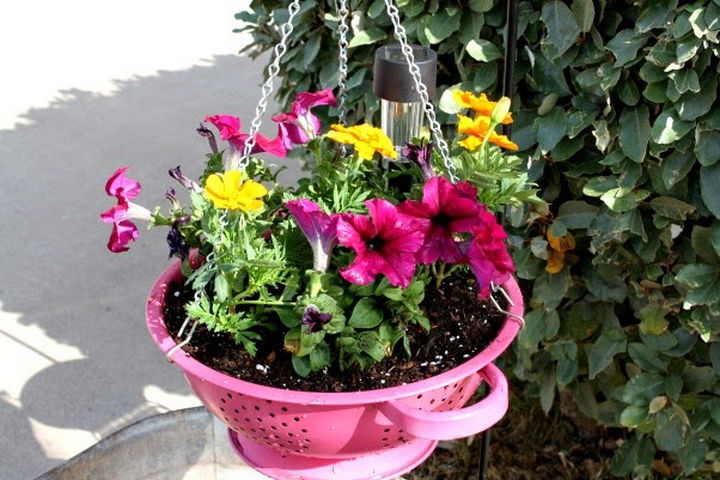 14 DIY Gardening Tips & Projects - Build a DIY hanging colander planter.