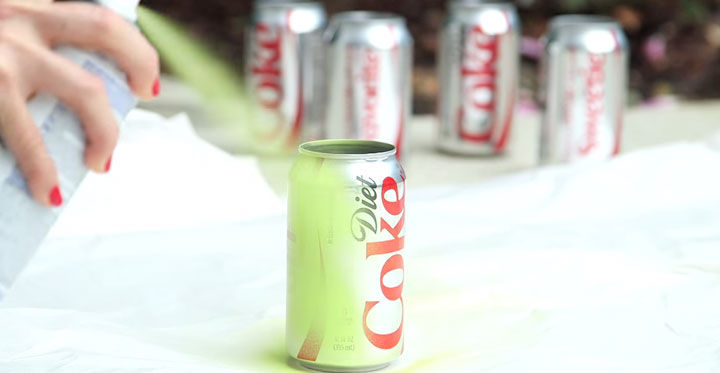 14 DIY Gardening Tips & Projects - Turn soda cans into decorative planters.