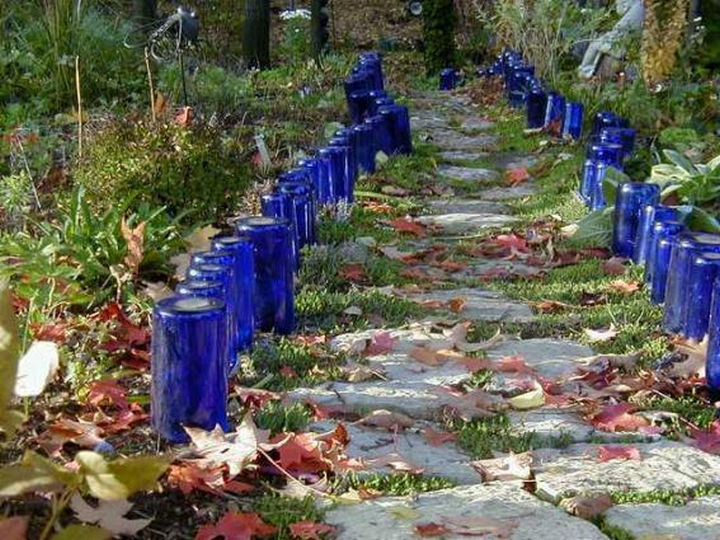 14 DIY Gardening Tips & Projects - Use wine bottles to create beautiful garden edging.