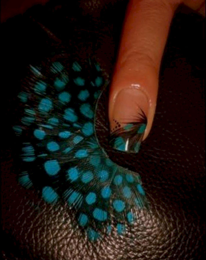 18 Feather Nail Art Designs - A French manicure with a feather like no other.