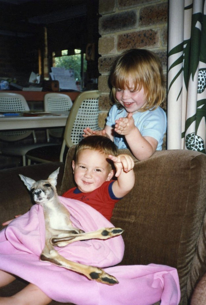 46 Happy Images - These kids enjoying an afternoon with their pet kangaroo.