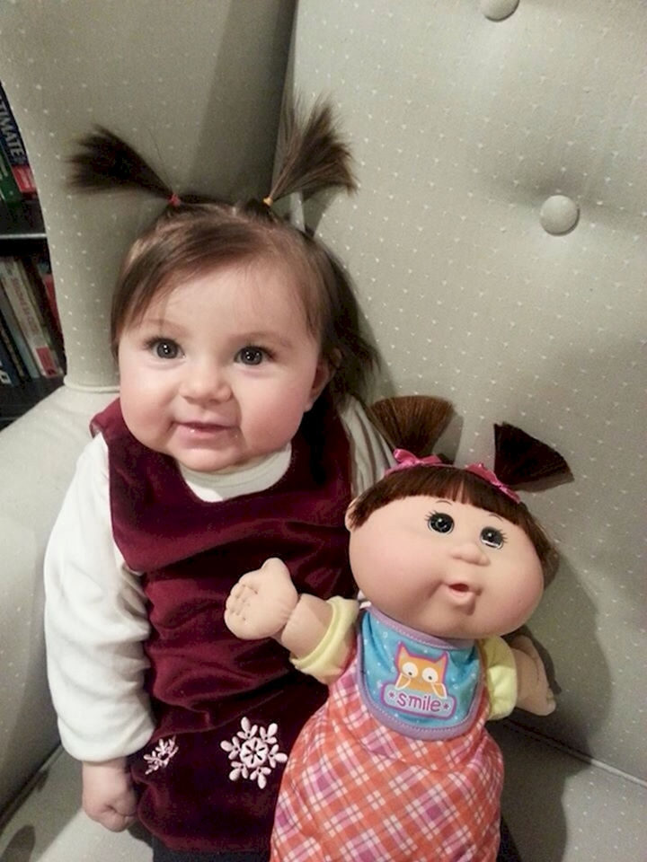 13 Babies That Resemble Celebrities or Something Else - They're both so cute, I can't tell if they're both dolls!