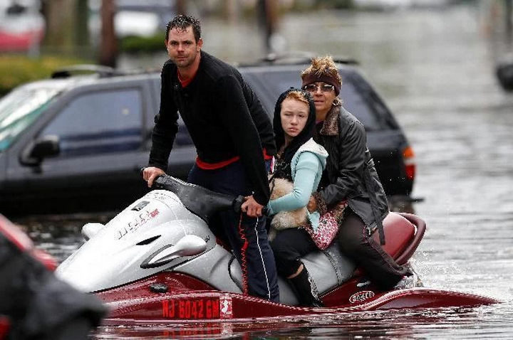 15 Incredible Photos Will Warm Your Heart - After Hurricane Sandy hit, ayoung man fromLittle Ferry, New Jersey helpsneighbours escape the flood waters with his jet ski.