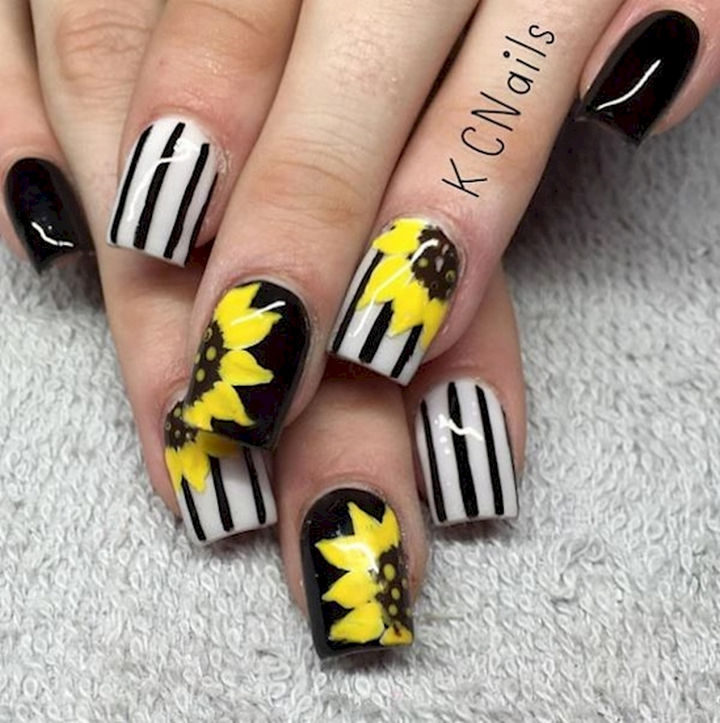 Vibrant yellow sunflower spring nails.