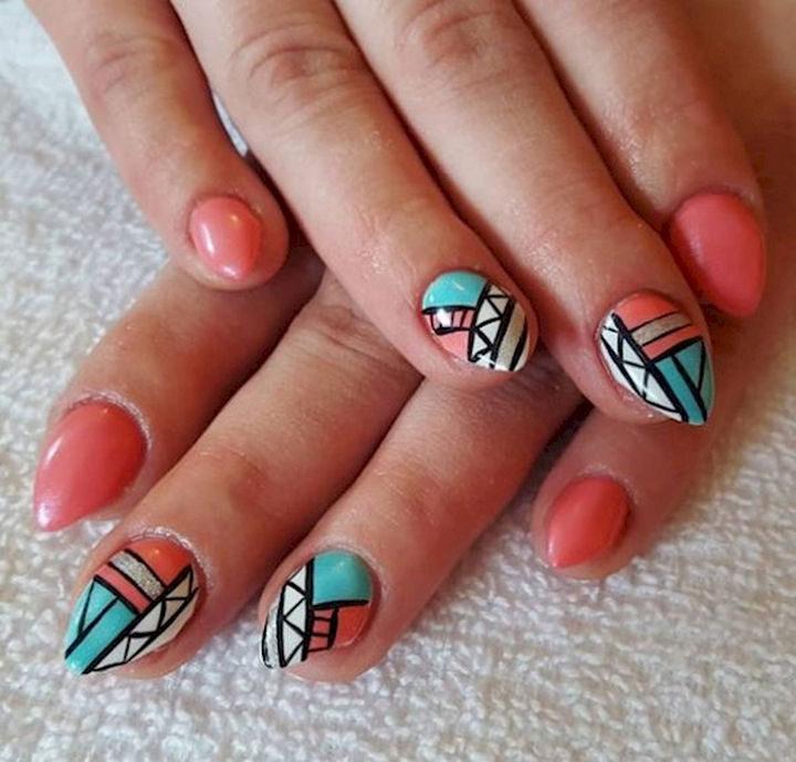 Spring nail art design with unique Aztec pattern accents.