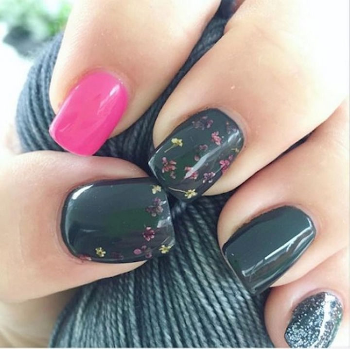 Spring nails with dried flower accents.