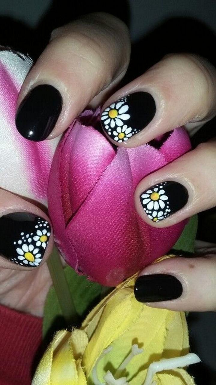 Pretty white daisies on aglossy black canvas.