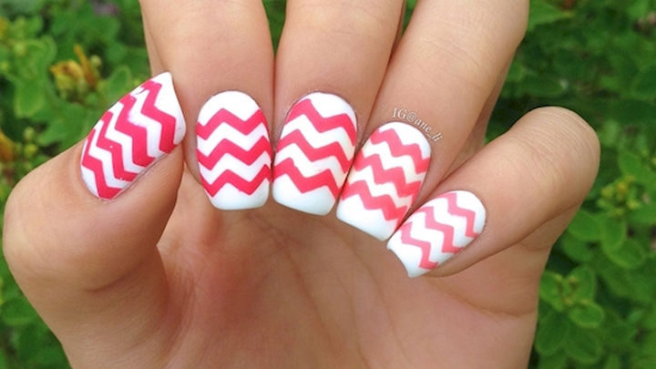 17 Chevron Nails - Chevron nails with hot pink chevron patterns that really get noticed.