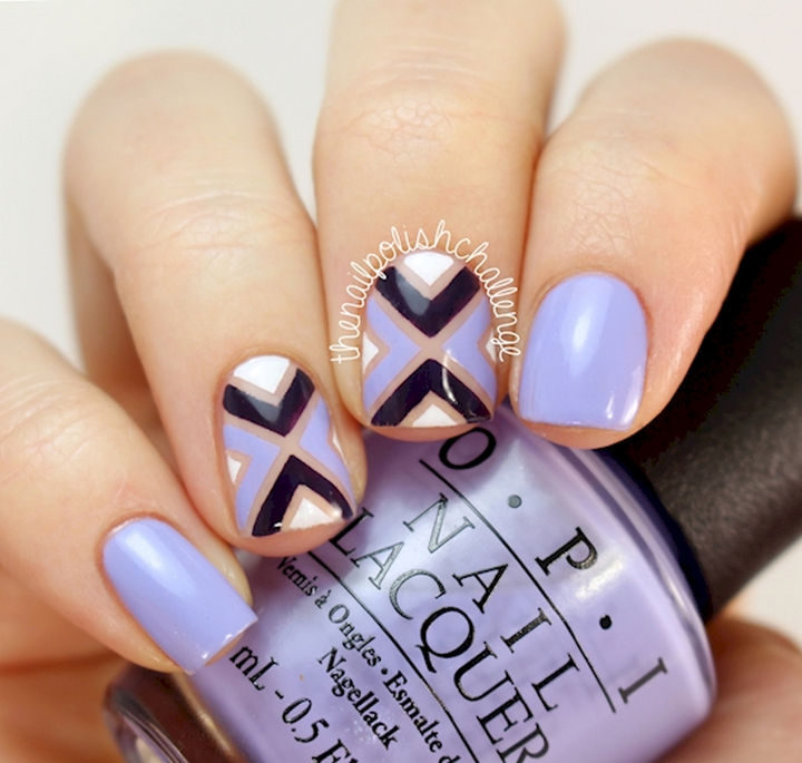 This purple nail art design looks awesome.