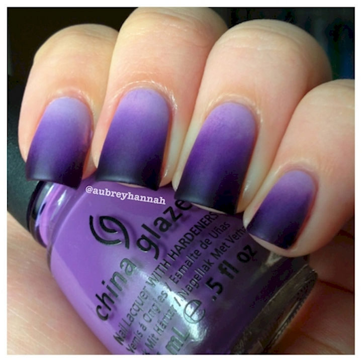 Look trendy with purple ombre nails.