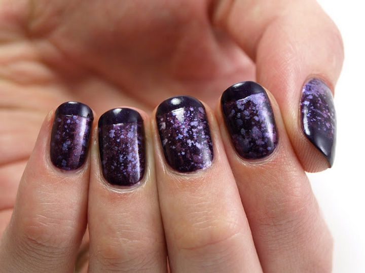 A unique French manicure with galaxy nails.
