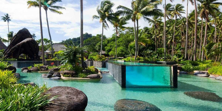 35 Epic Swimming Pools From Around the World - Laucala Island Resort in Fiji.