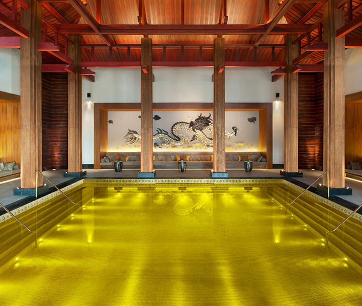 35 Epic Swimming Pools From Around the World - Gold energy pool at St. Regis in Lhasa, Tibet.