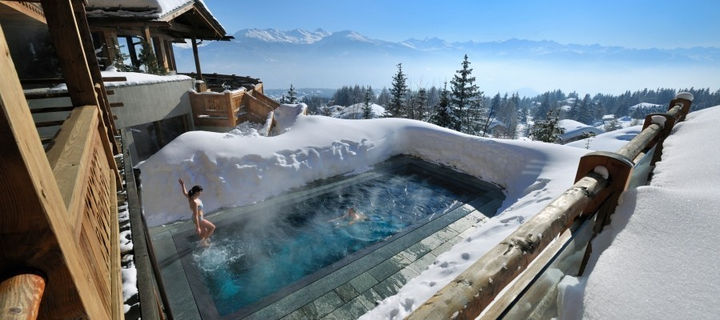 35 Epic Swimming Pools From Around the World - LeCrans Hotel and Spa in Crans Montana, Switzerland.