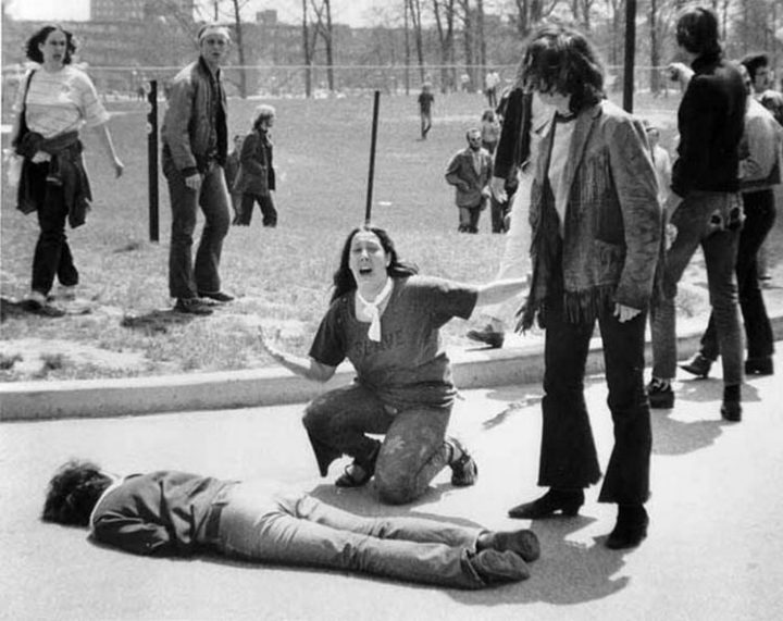 9 Heartbreaking Images - During theKent State University shootings in 1970, the friend of a killed student cries for help.