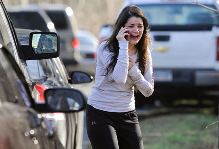 9 Heartbreaking Images - The sister of a teacher at Sandy Hook Elementary School learns that she was killed.