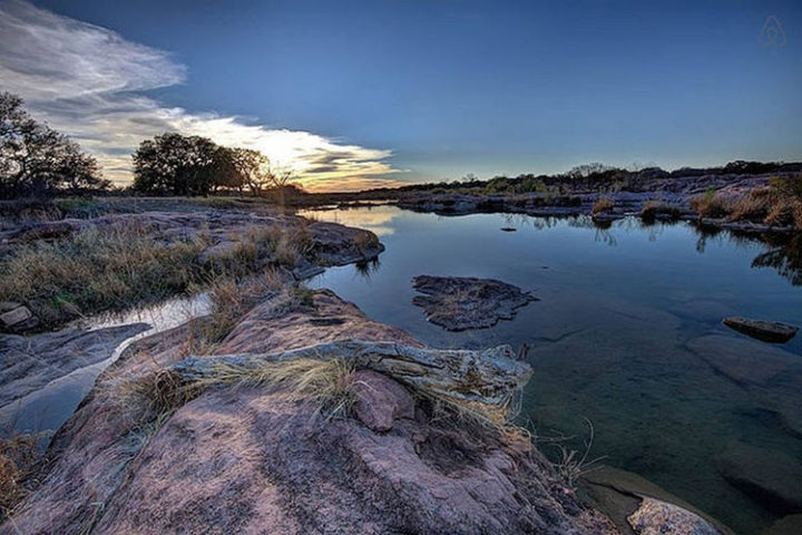 They purchased a ten-acre lot on the Llano River just outside of Austin, Texas.