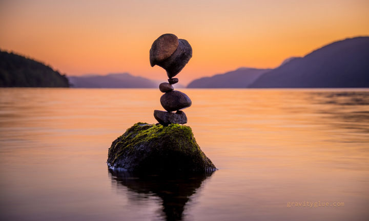 """He creates incredible rock art by carefully stacking each rock with nothing but gravity and tons of skill. He calls it """"gravity glue."""""""