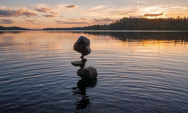 What is his secret to getting rocks to balance with unbelievable precision?