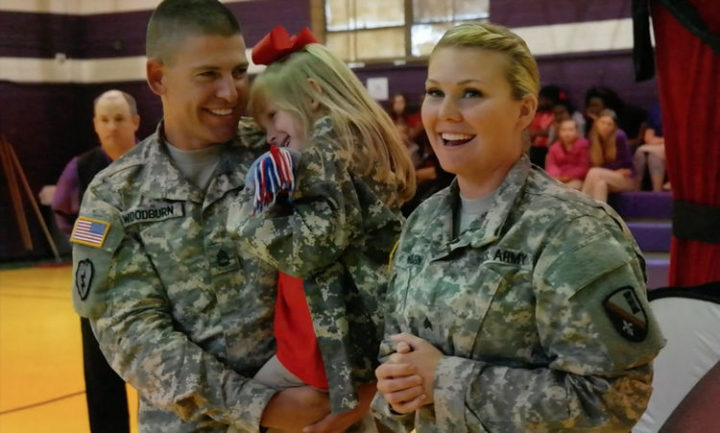 15 Emotional Photos of Soldiers Coming Home - Soldiers coming home andsurprising their daughter during a school magic show.